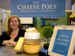 Erin Harris runs the Cheese Poet booth in the Western Fair Farmers' Market. She will even do catering, like creating cheese platters for weddings. (MIKE HENSEN, The London Free Press)