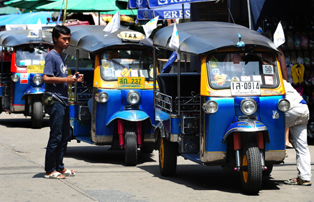 Tuk-tuk drivers wait for tourists along