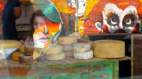 Graffitti, typical in the SP scenario, reflected on the display window of A Queijaria, specialty cheese shop, managed by Fernandto Soares